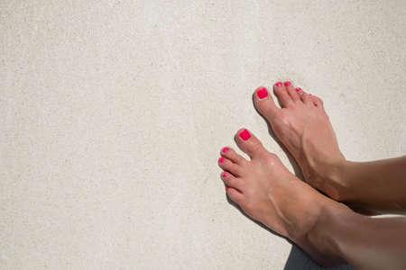 feet in sand: Bare womans feet on the beach sand Stock Photo
