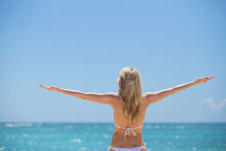 sexy female body: Woman enjoying summer by the ocean Stock Photo