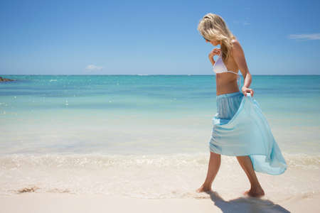 fresh girl: Young woman walking on the beach