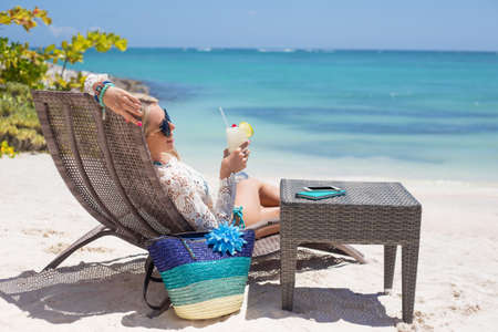drink at the beach: Woman relaxing on the beach Stock Photo