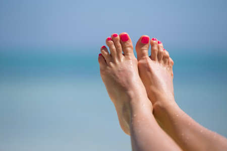 bare girl: Bare womans feet on the beach
