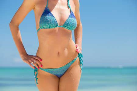 swimsuit model: Attractive female in blue bikini