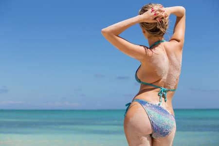posing: Woman in bikini posing in the ocean