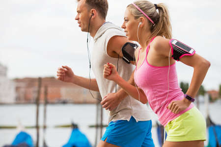 run woman: Couple running outdoors Stock Photo