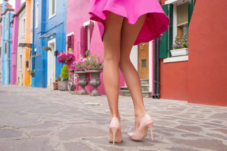 skirts: Woman wearing high heel shoes and mini skirt