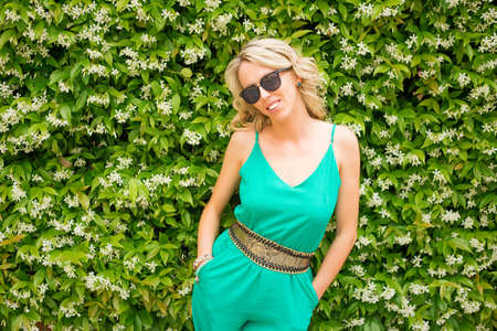 jumpsuit: Fashionable woman wearing green jumpsuit