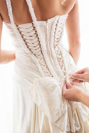 lace pattern: Tying brides dress Stock Photo