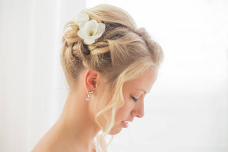 radiant light: Brides hairstyle with flowers