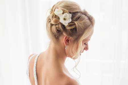 woman hairstyle: Beautiful brides hairstyle for wedding Stock Photo
