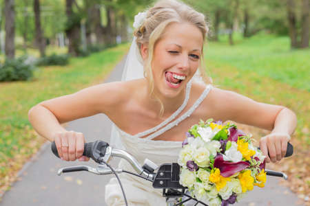 flirty: Bride on a bicycle being flirty
