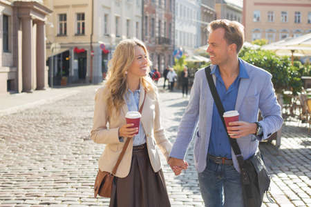 a young old couple: Man and woman looking at each other and holding hands Stock Photo