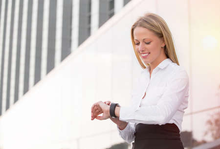 phone the clock: Business woman looking at watch