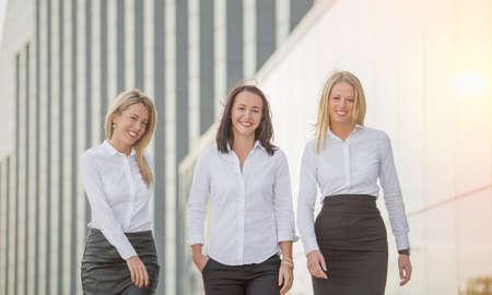 corporate women: Three business women walking