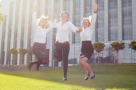 women business: Happy corporate business women jumping