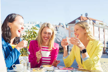 having a break: Three women laughing
