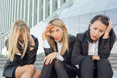 desperate face: Three desperate business women