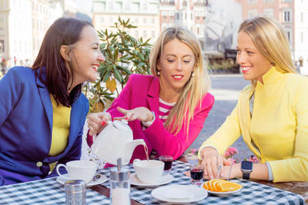 three women: Women having lunch break Stock Photo