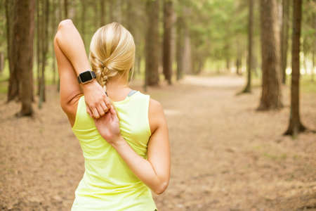 Athletic girl stretching her arms