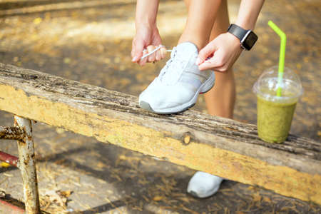 lace up: Tying workout shoes Stock Photo