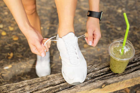athletic wear: Tying running shoes