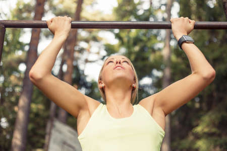 pull up: Athletic woman doing pull up
