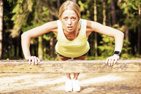 determined: Woman doing pushups