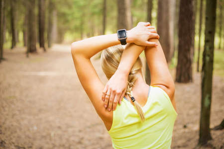 strong arm: Woman stretching before physical activity Stock Photo