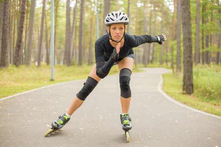 Active woman roller skating Banco de Imagens