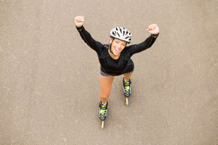 roller skate: Successful roller skating athlete celebrating