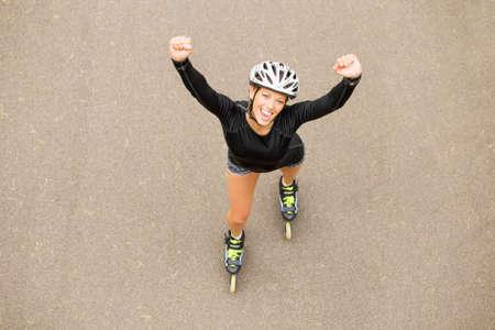 skating fun: Successful roller skating athlete celebrating