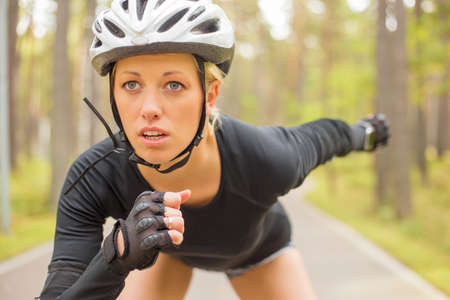 competition success: Woman athlete in helmet Stock Photo