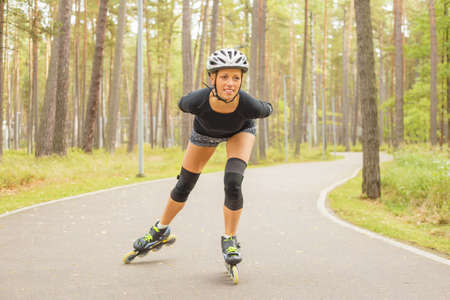roller blade: Active woman on roller skates training