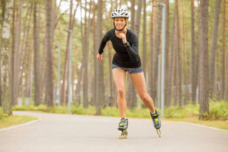 rollerblade: Happy and athletic roller skater practicing Stock Photo