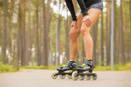 blades: Fit woman or roller skates resting Stock Photo