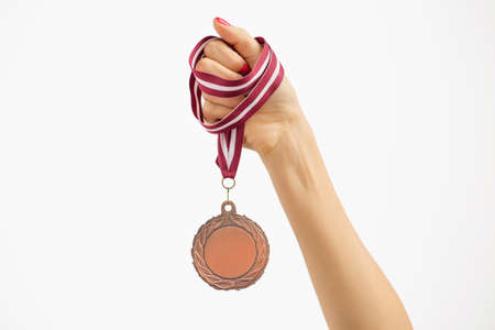 winning woman: Person holding a medal Stock Photo
