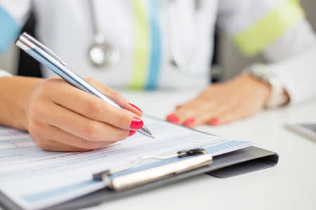 medical person: Woman doctor writing Stock Photo