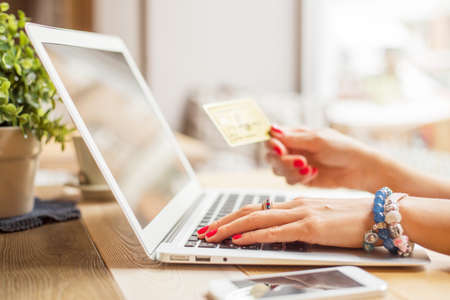 credit card purchase: Woman using modern technology Stock Photo
