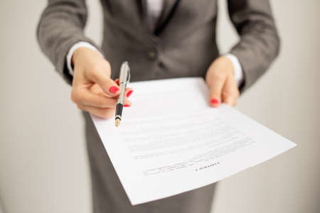 applications: Woman offering to sign papers Stock Photo