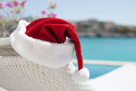 white party: Red Christmas hat by the pool