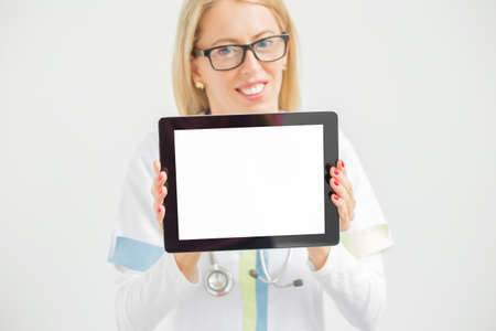 media equipment: Doctor smiling and showing tablet