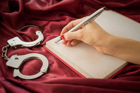 Female writing in notebook Stock Photo