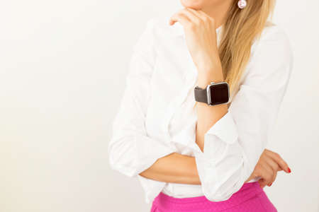 wearable: Woman standing with smartwatch around her wrist