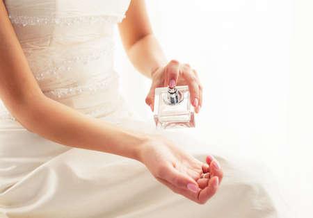 sprays: Bride spraying perfume