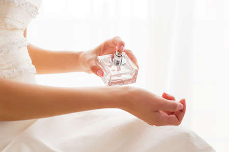 applying: Bride using perfume