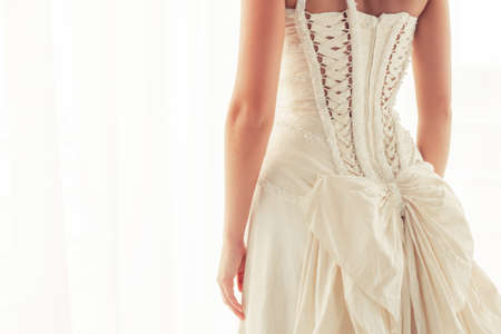gown: Brides corset from back