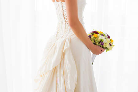 wedding gown: Wedding gown and flowers