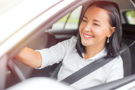 buckled: Buckled up woman driving