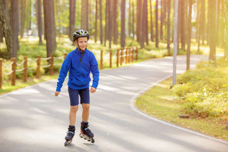 young child: Child on roller skates Stock Photo