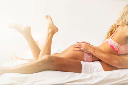 sexual nude: Woman and man in underwear laying in bed