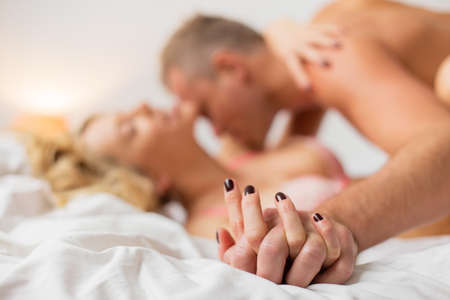female sex: Man and woman holding hands while making love